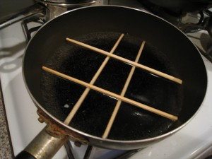 Creative steaming rack using two pairs of chopsticks